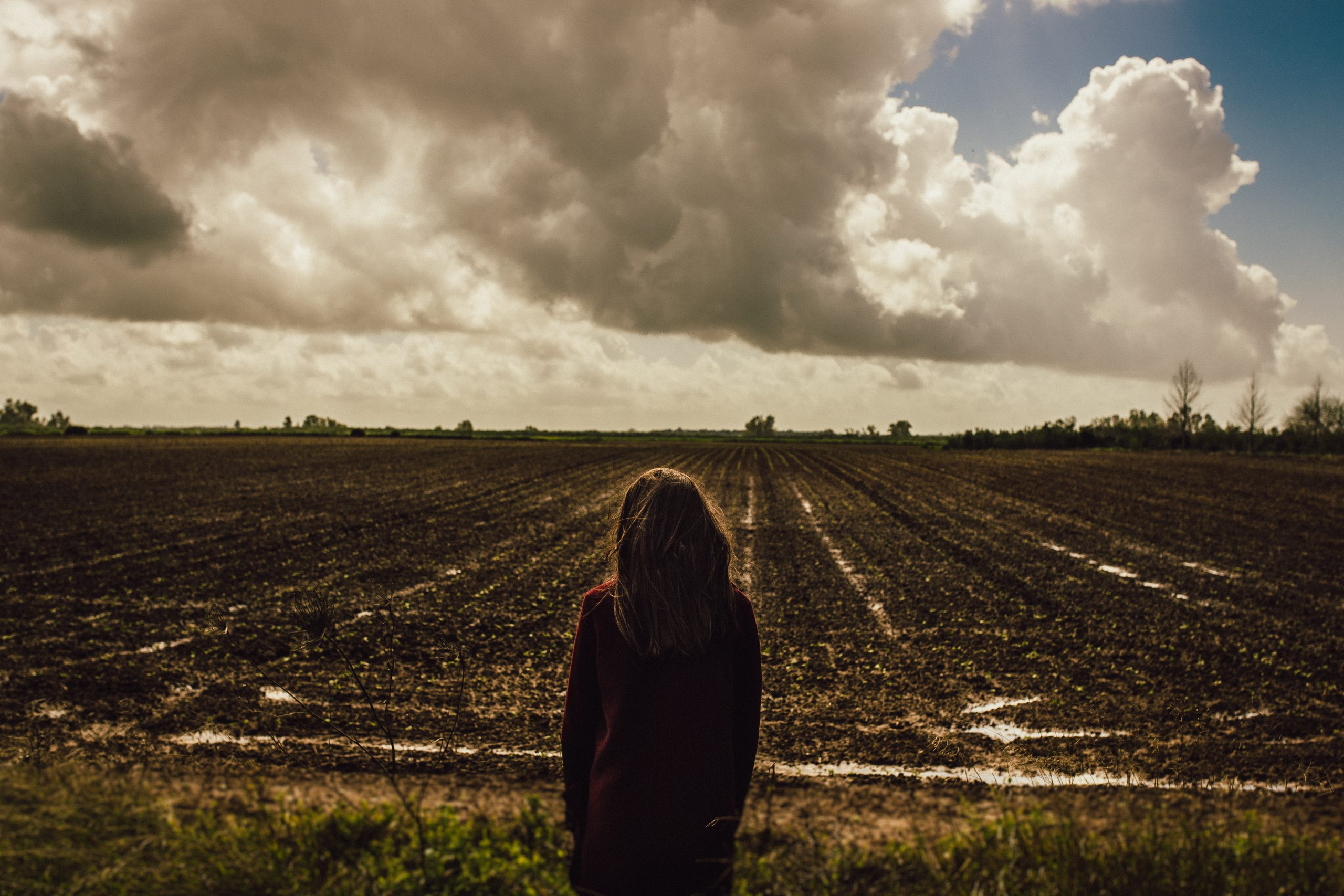 Woman standing in the middle of the field